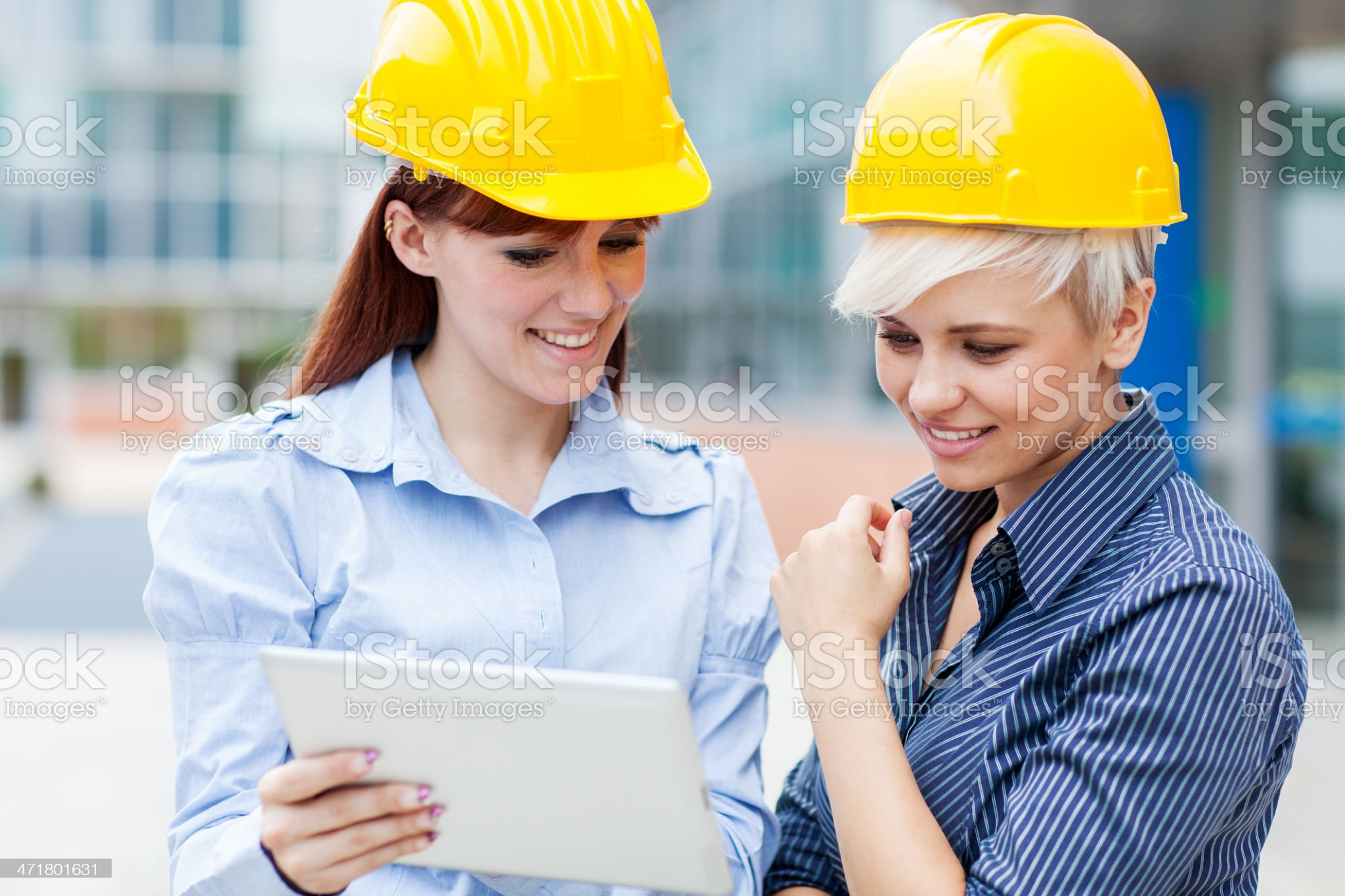 Female constructors are discussing their project royalty-free stock photo