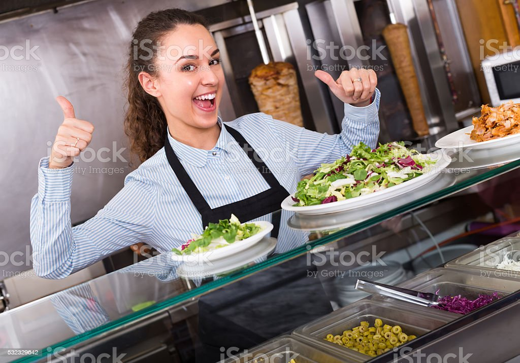 Female cook at bistro stock photo