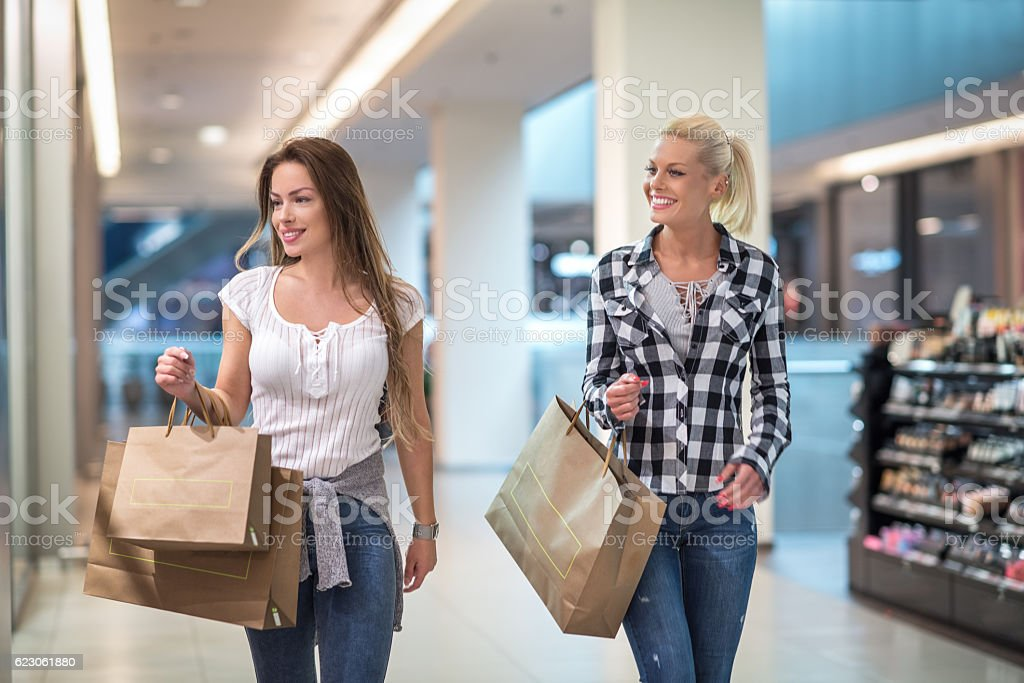 Female couple in shopping mall stock photo