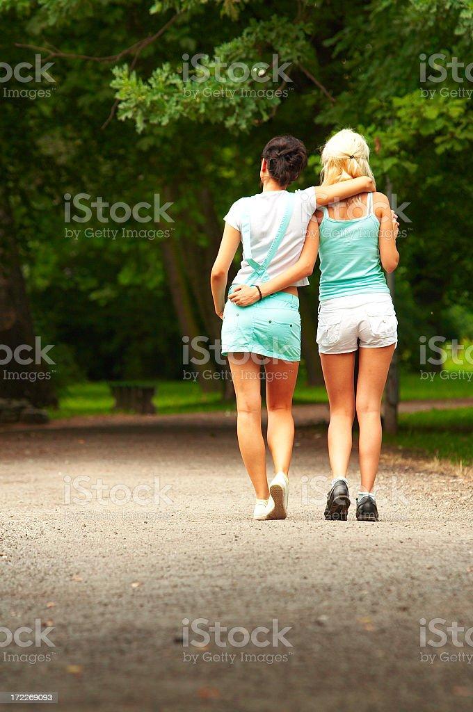 Female couple walking royalty-free stock photo
