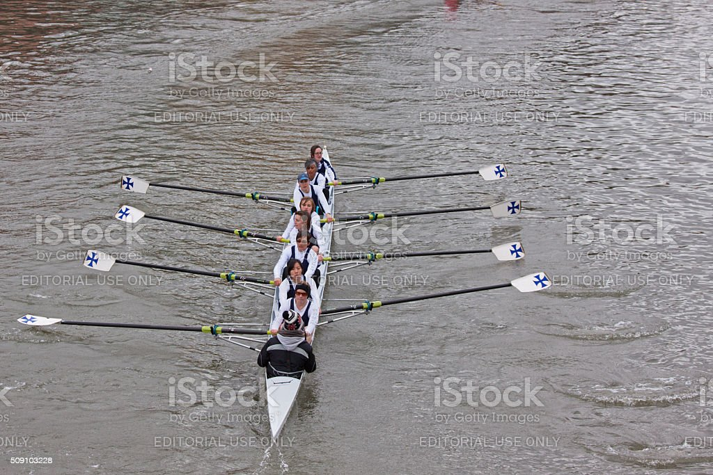 Female crew pulling together in a river race UK stock photo