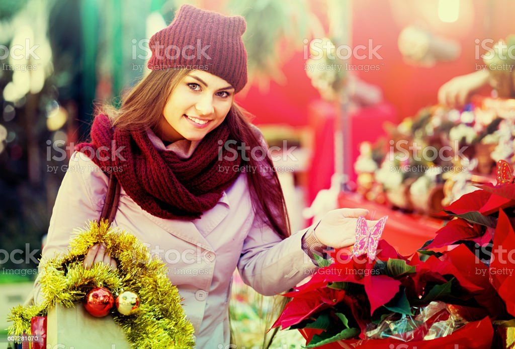 female customer choosing  decorations stock photo