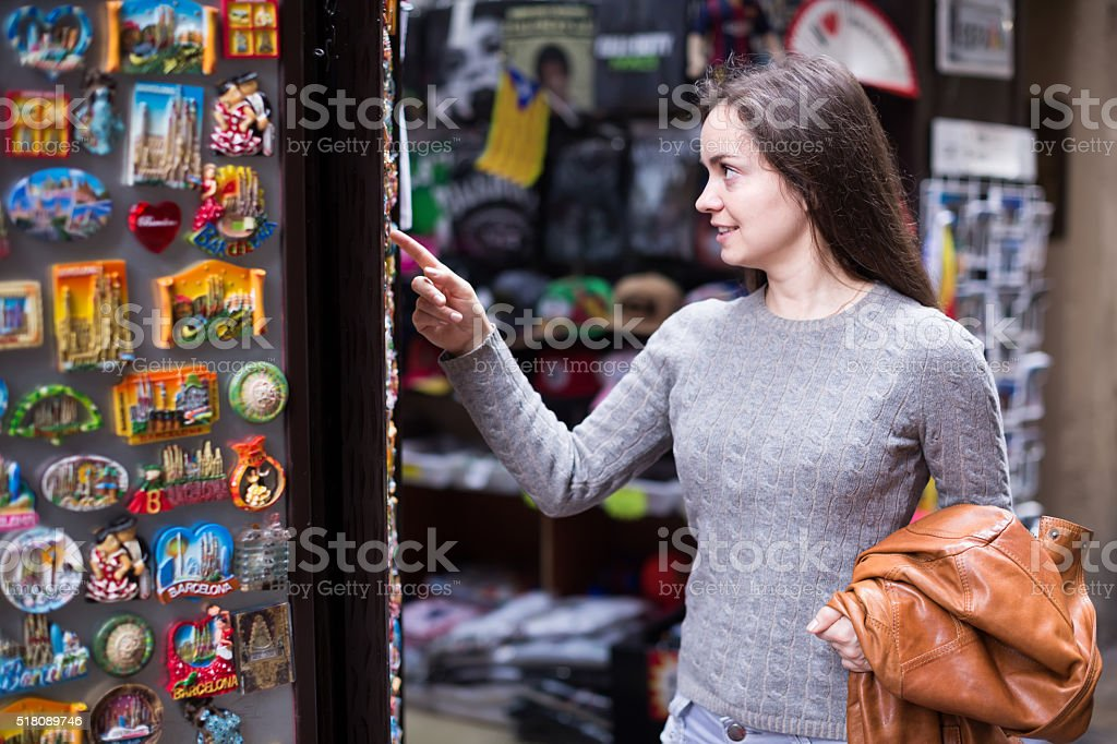 Female customer in souvenir shop stock photo