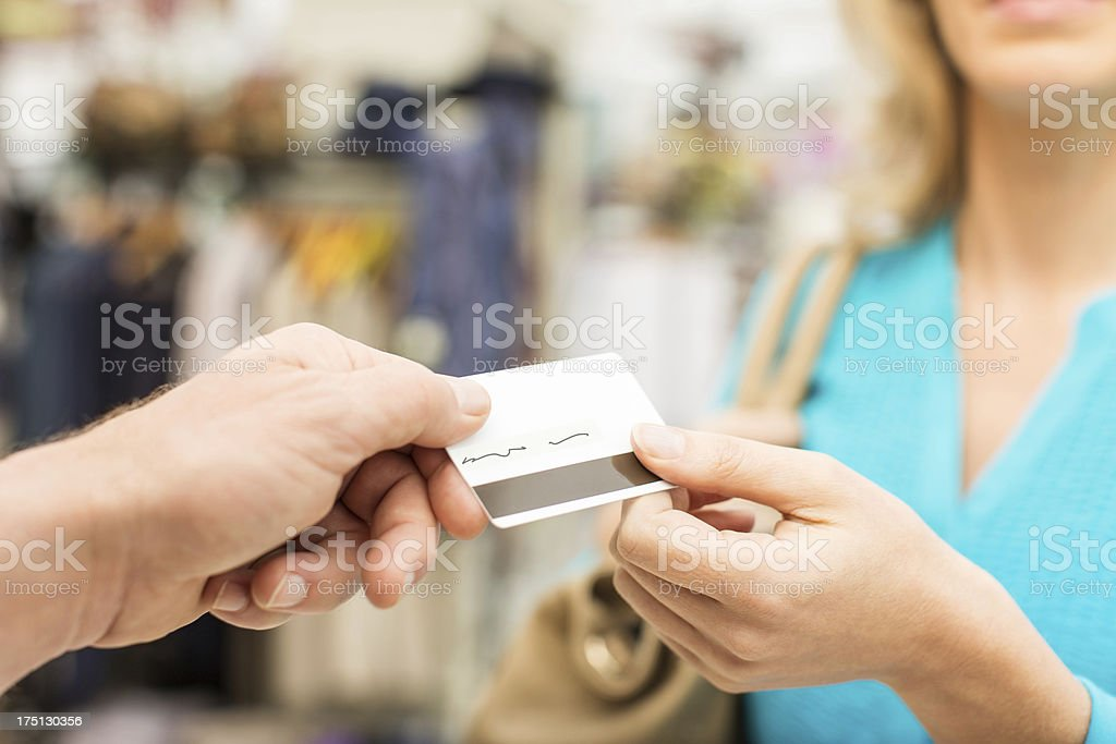 Female Customer Paying Through Credit card stock photo
