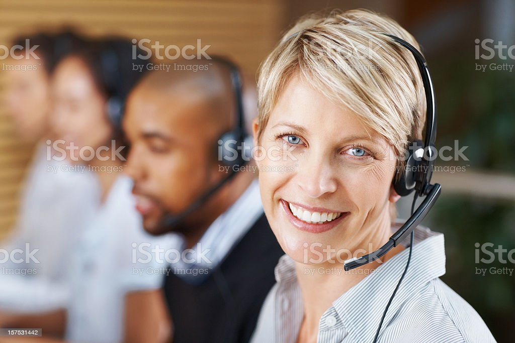 Female customer service representative smiling at work royalty-free stock photo