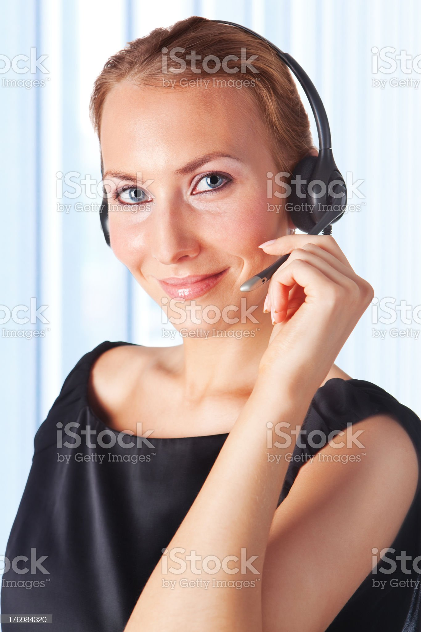 female customer service representative working with headset royalty-free stock photo