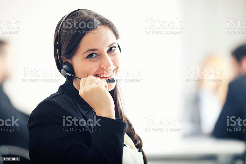 Female customer service worker smiling royalty-free stock photo