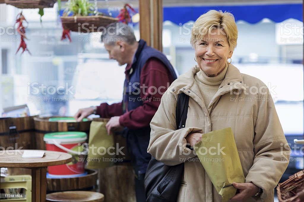 Female customer shopping at a Green Grocer stock photo