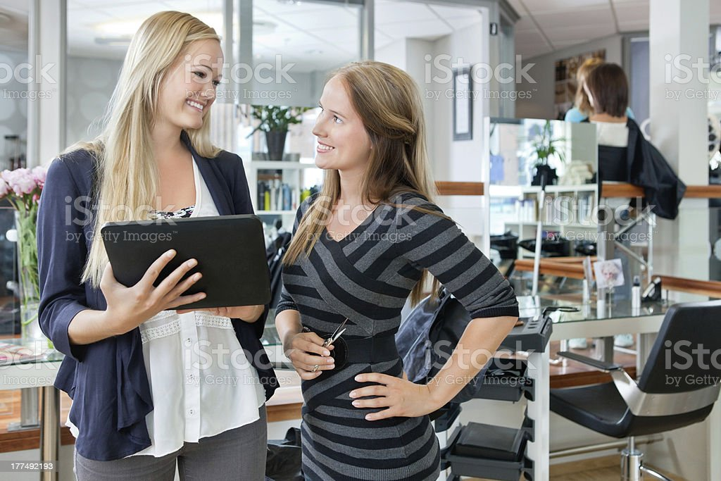 Female Customer With Digital Tablet royalty-free stock photo