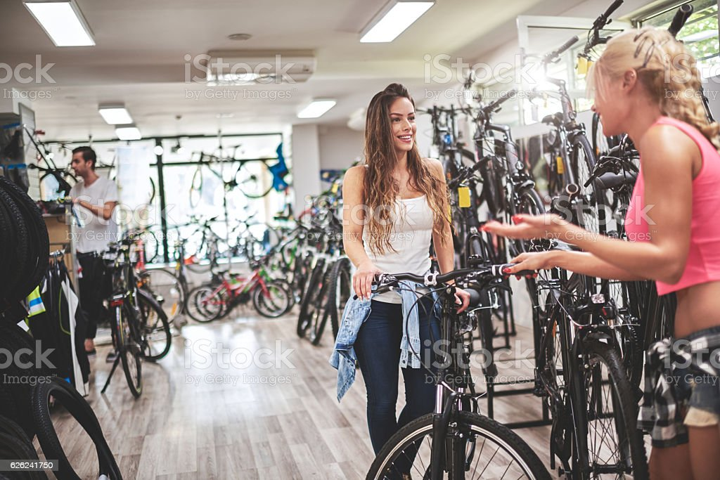 Female customers in bicycle store stock photo
