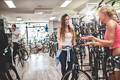 Female customers in bicycle store
