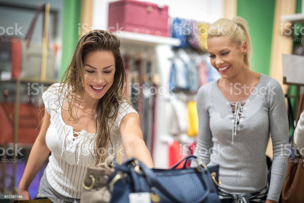 Female customers in luggage store stock photo