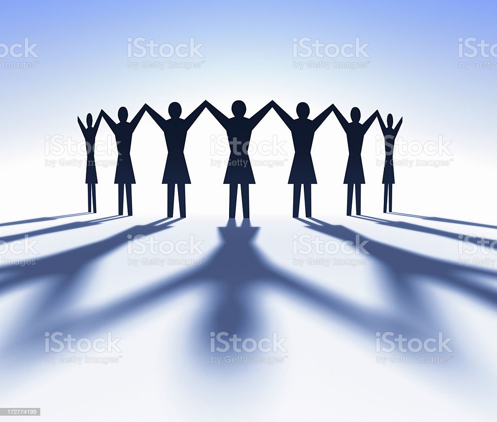 Female cutouts holding hands with arms raised stock photo