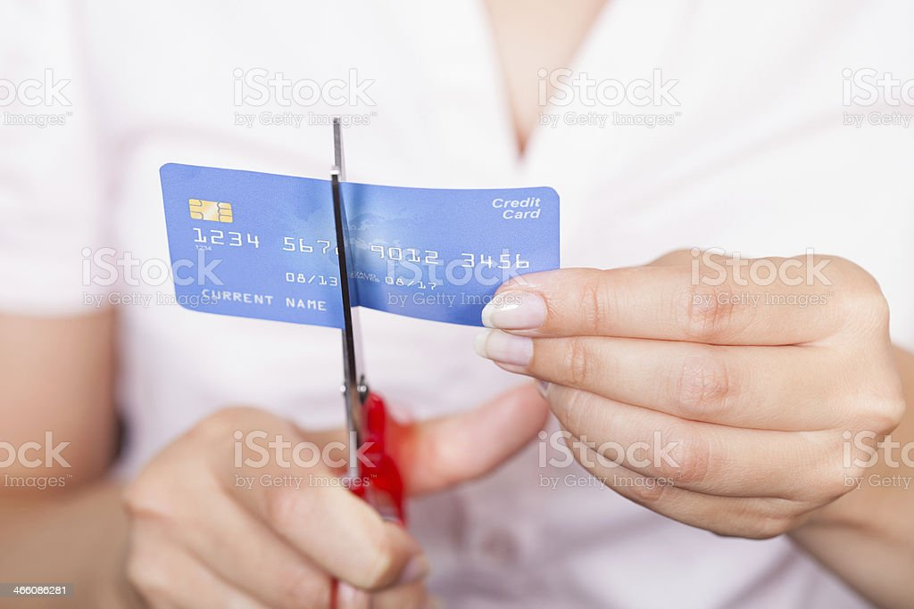 Female Cutting Credit Card stock photo
