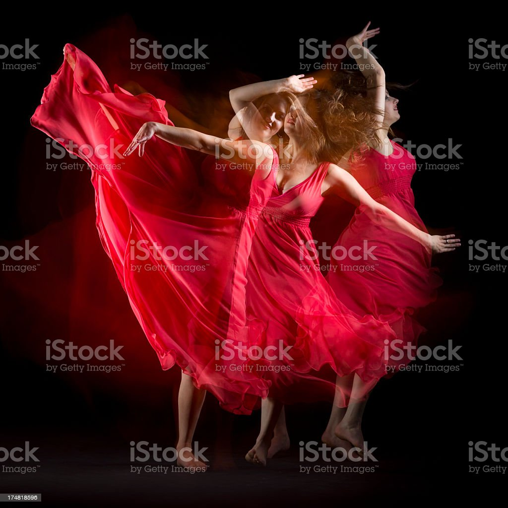 Female Dancer in red dress build patterns on black royalty-free stock photo