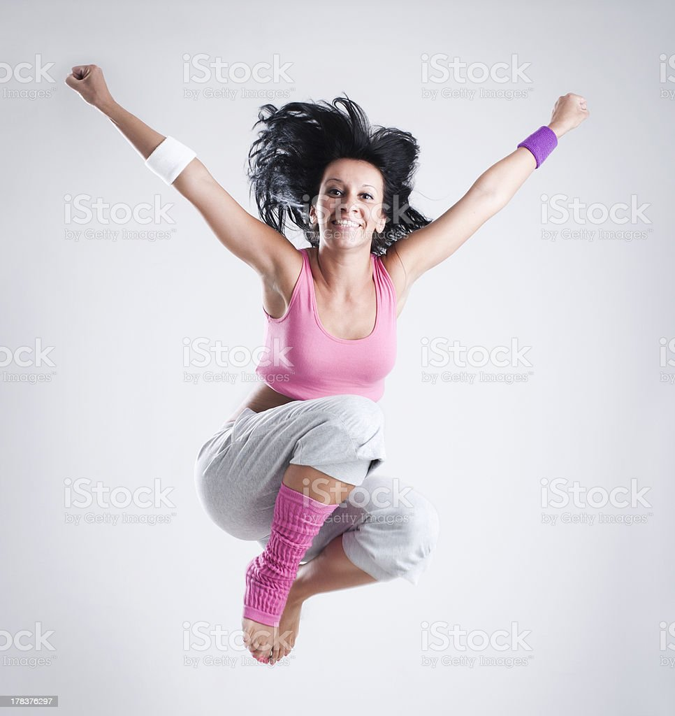 Female dancer jumping in the air stock photo