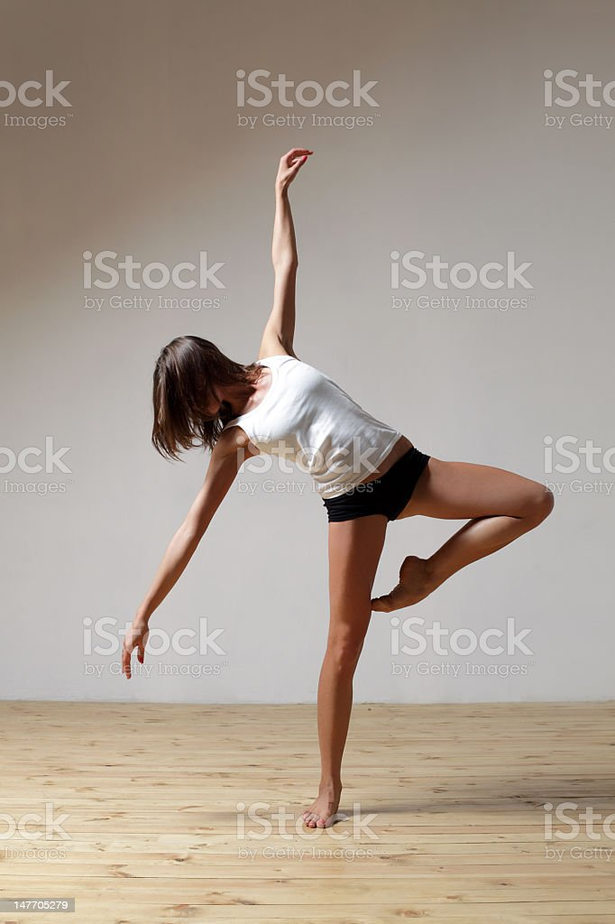 Female dancer posing in one foot stock photo