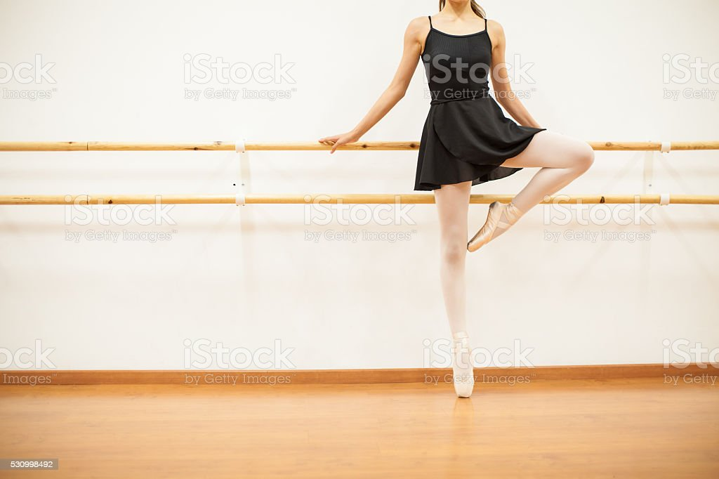 Female dancer standing on her toes stock photo