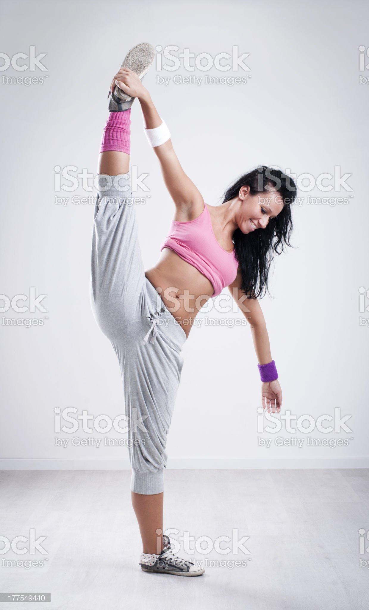 Female dancer stretching her leg royalty-free stock photo