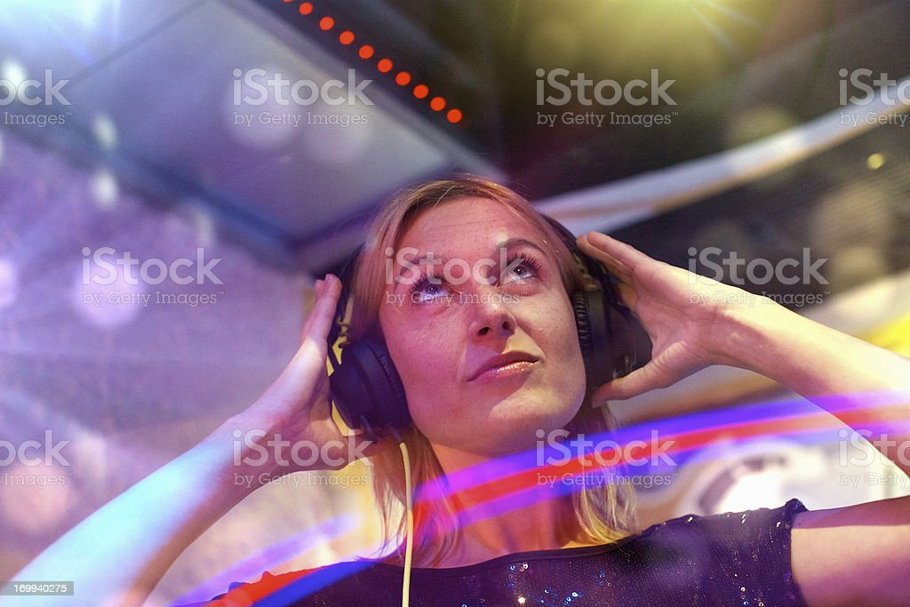 Female Deejay playing music stock photo