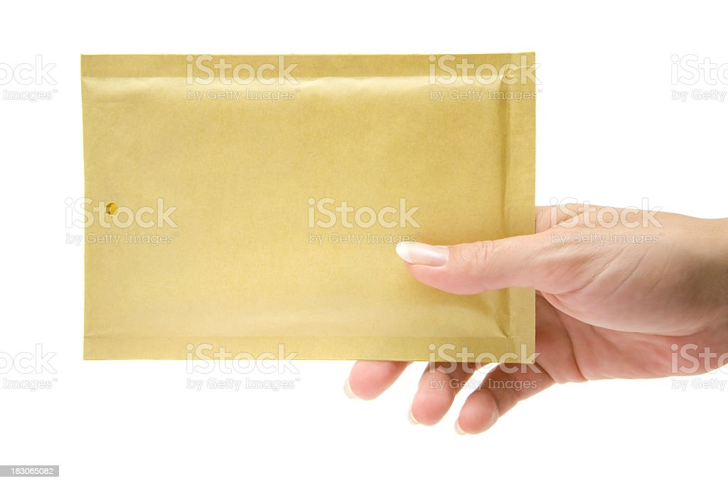 Female delivering a beige envelope royalty-free stock photo