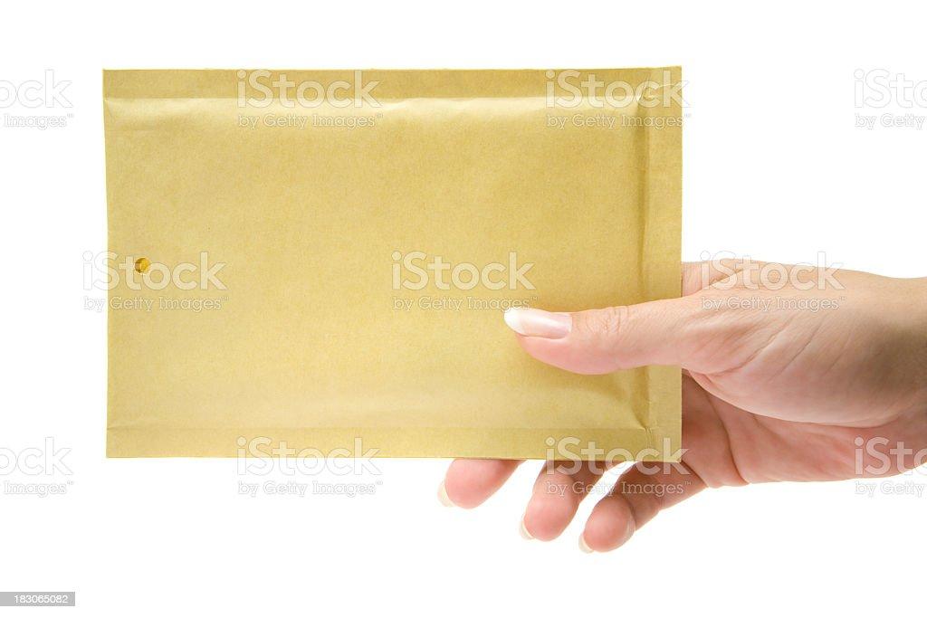 Female delivering a beige envelope stock photo