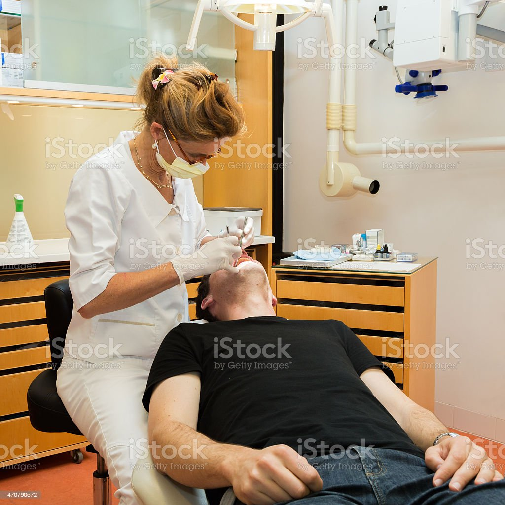Female dentist and her male patient (the Netherlands) stock photo