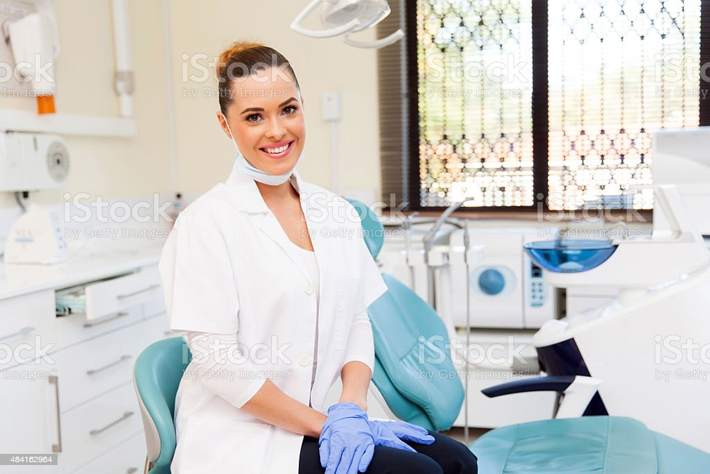 female dentist in office stock photo