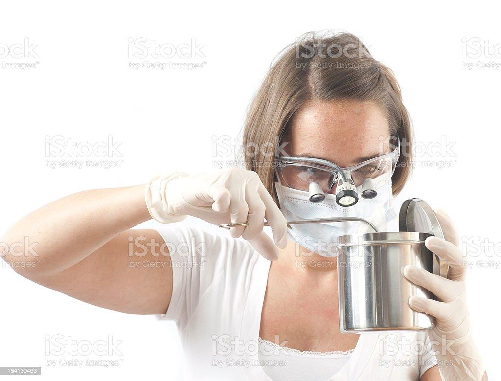 female dentist on white background - Lupenbrille stock photo