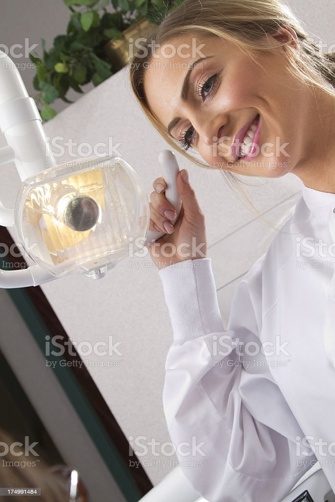 Female dentist smiles at patient royalty-free stock photo
