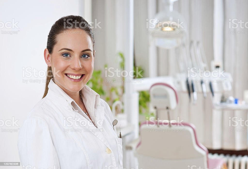 Female dentist smiling for portrait at her practice stock photo