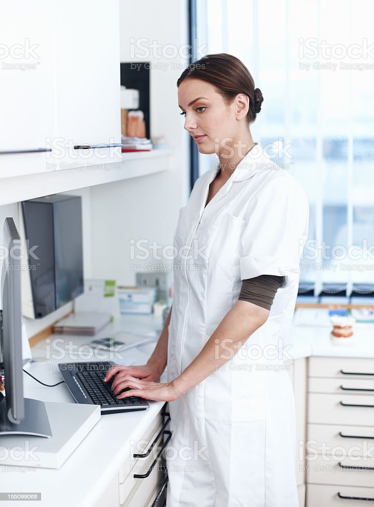 Female dentist using computer royalty-free stock photo