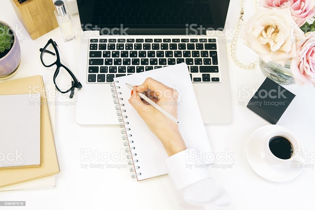 Female desktop writing stock photo