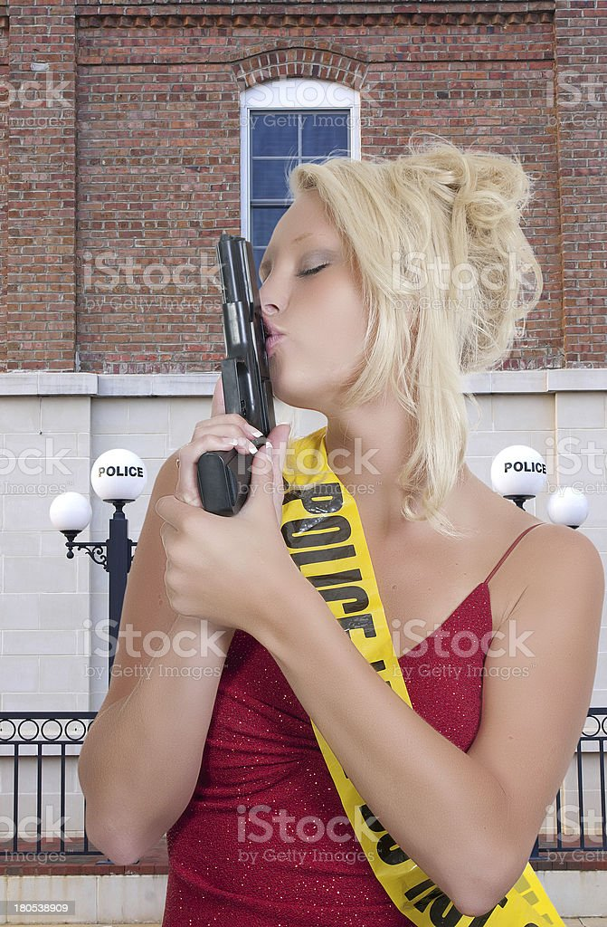 Female Detective Kissing Gun stock photo