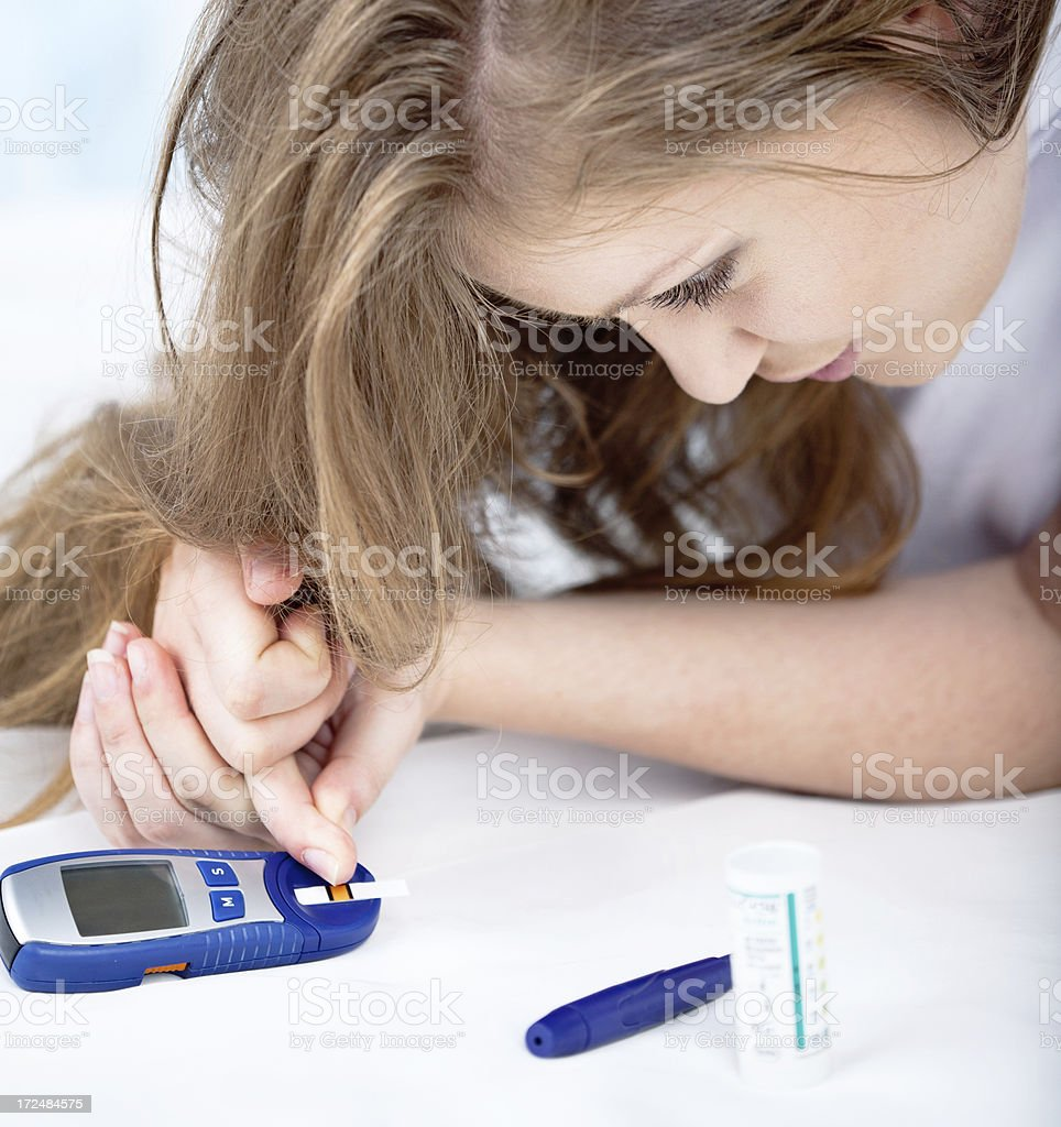 Female Diabetic Doing a Glucose Level Finger Blood Test . royalty-free stock photo