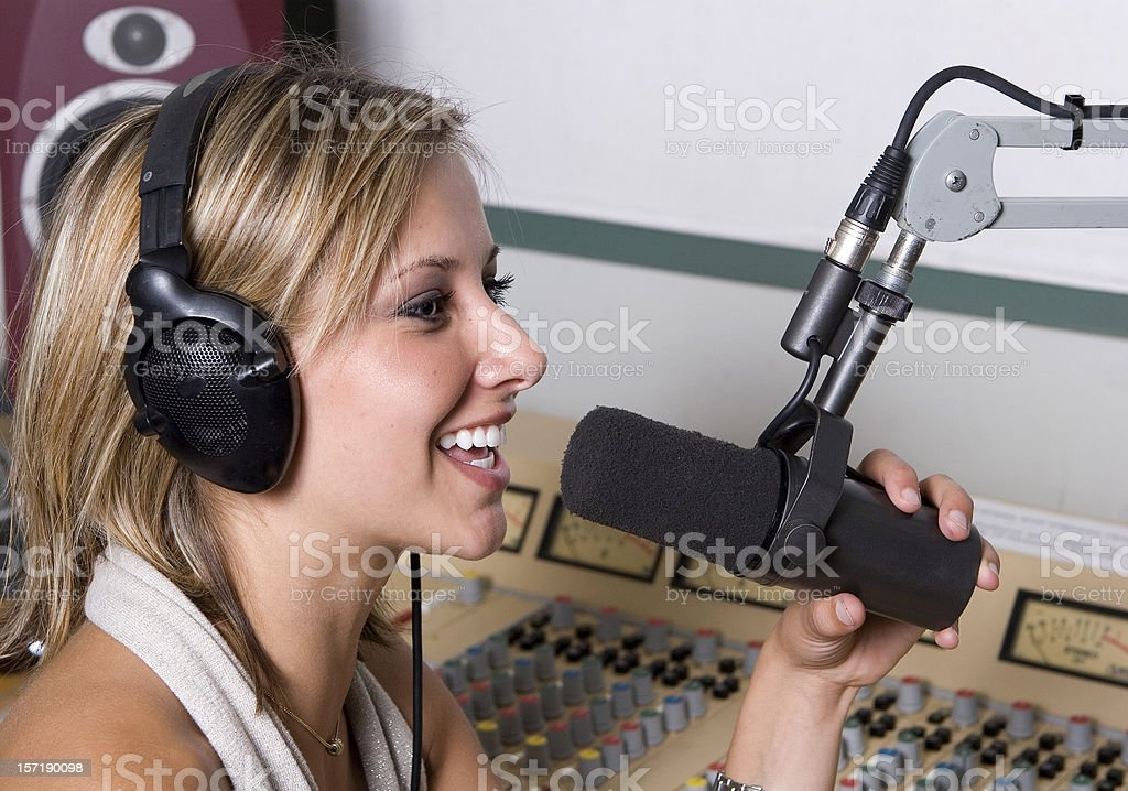A female disc jockey working in the studio stock photo