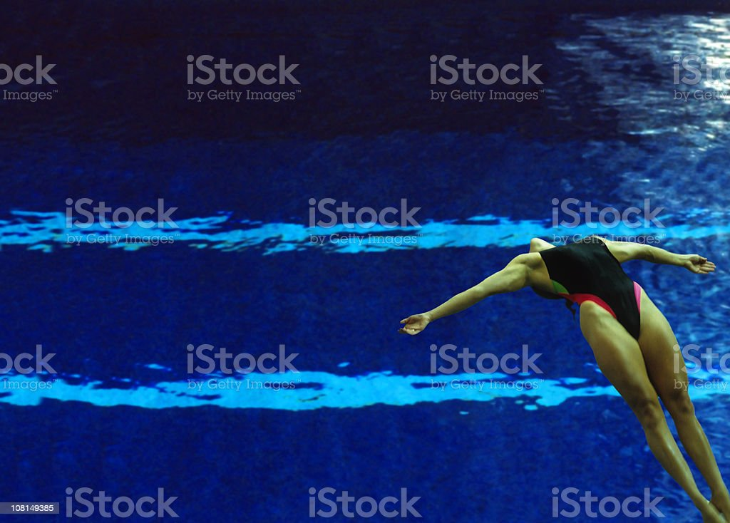 Female Diver Over Pool stock photo