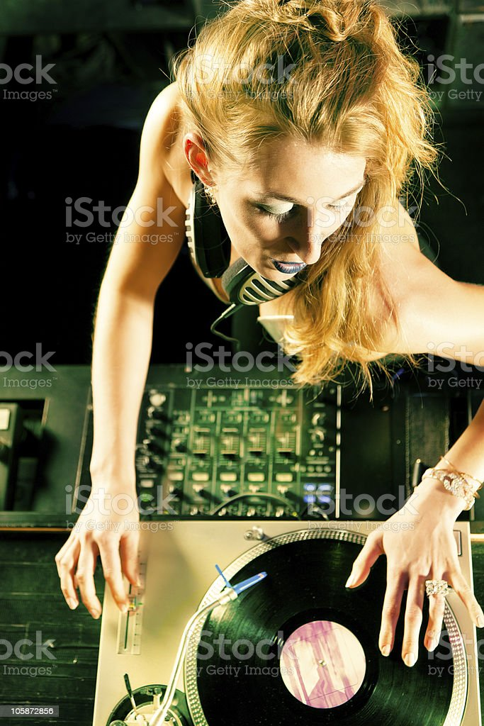 Female DJ at the turntable in Club stock photo