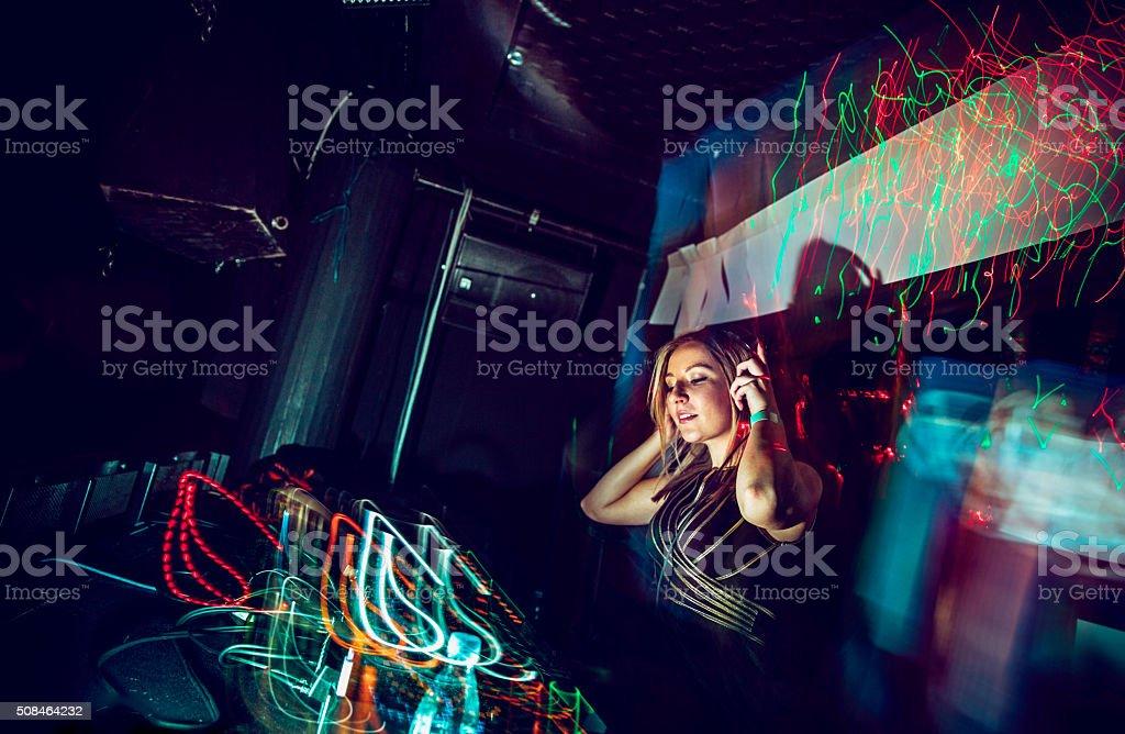 Female DJ in Nightclub stock photo