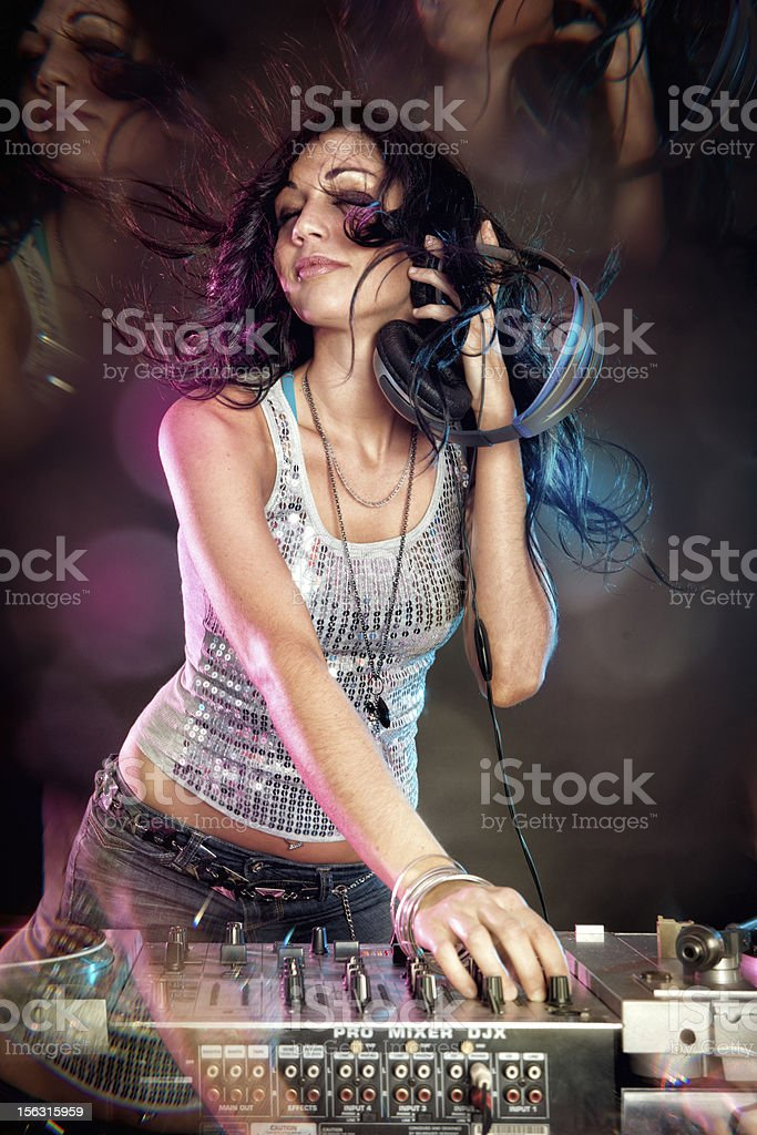 Female DJ playing music and dancing stock photo