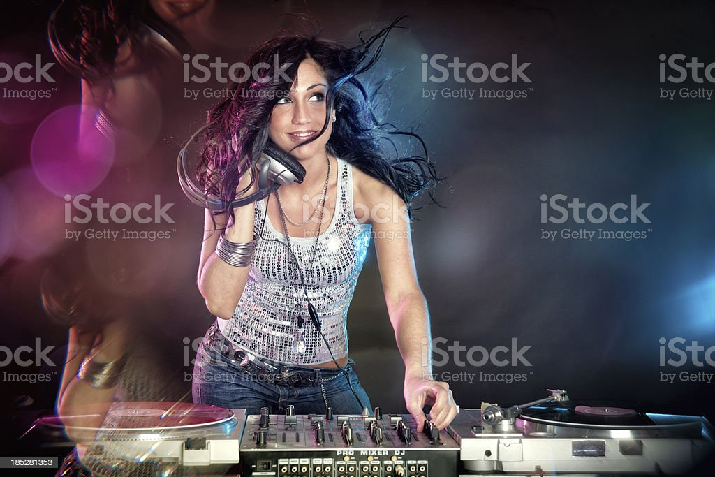 Female DJ playing music and dancing royalty-free stock photo