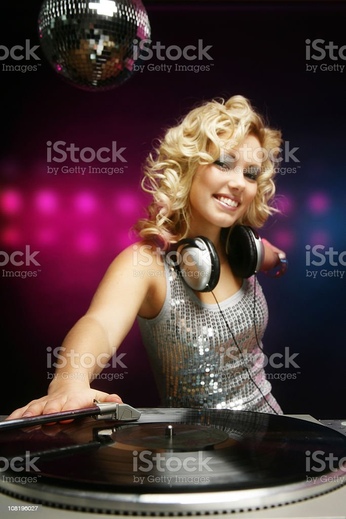 Female DJ playing music royalty-free stock photo