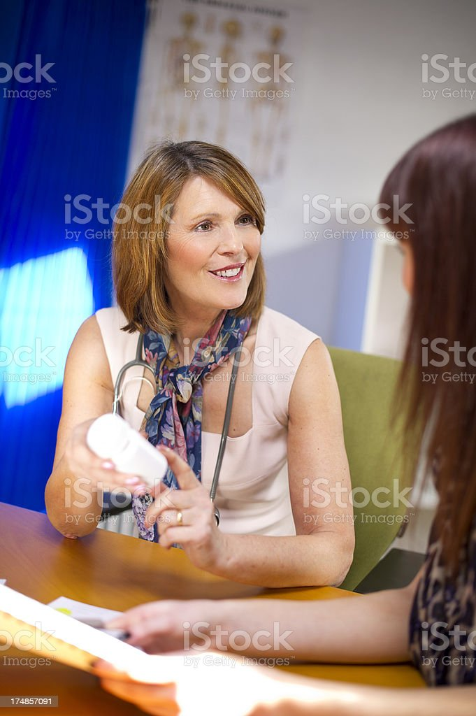 female doc explaining meds royalty-free stock photo