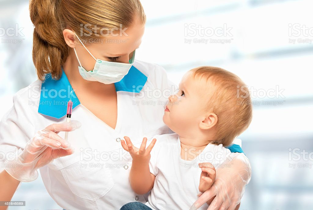 Female doctor about to give a child a vaccination royalty-free stock photo