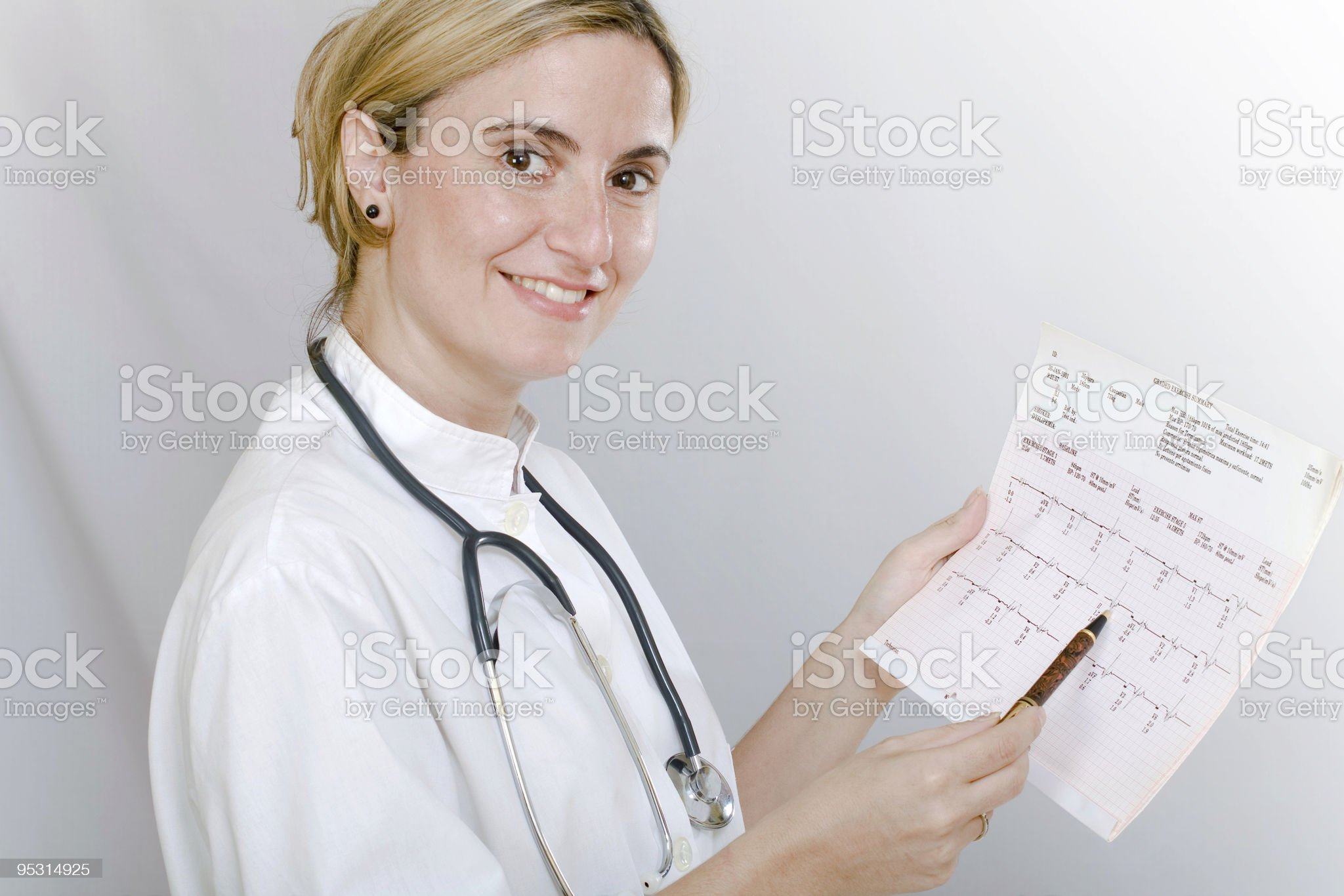 Female doctor analyzing pulse trace royalty-free stock photo