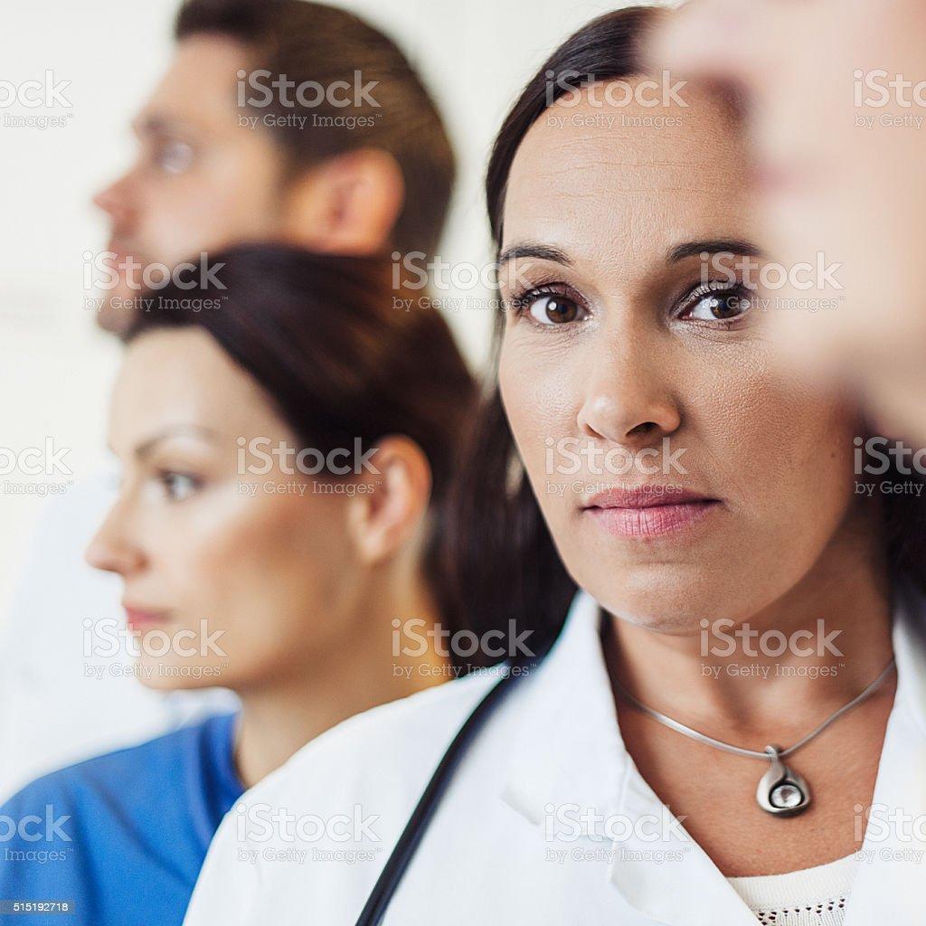 Female doctor and nurses at hospital stock photo
