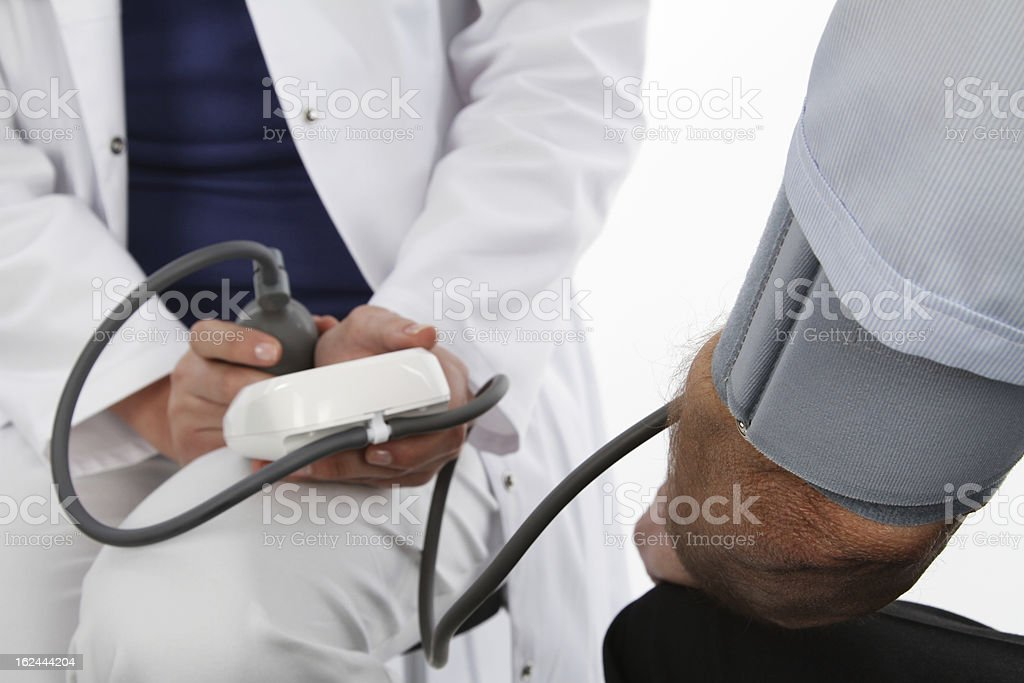 Female doctor and older man - pressure gauge royalty-free stock photo