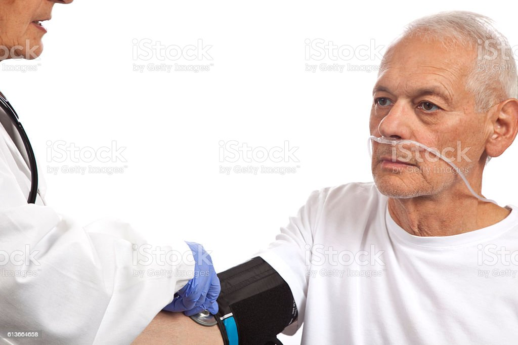Female Doctor checking blood pressure on patient with breathing tube stock photo
