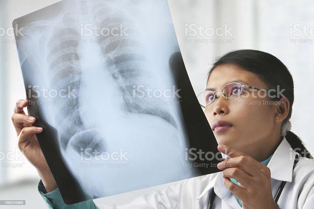 Female doctor checking xray image stock photo