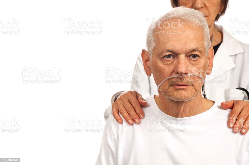 Female Doctor consoling male patient with hands on shoulders stock photo